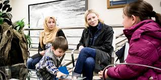Cate Blanchett speaking with refugees